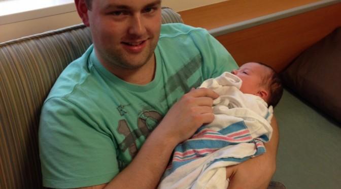 Uncle Matthew holding Madeleine